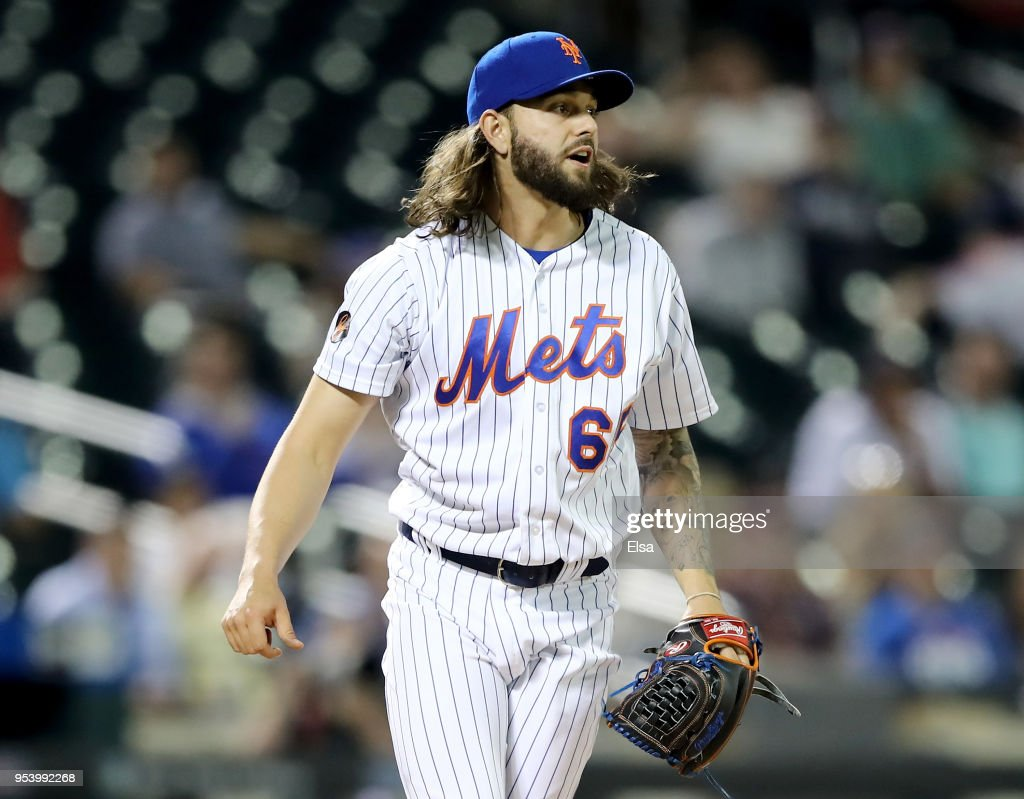 Robert Gsellman #65 of the New York Mets reacts after Ryan Flaherty of the Atlanta Braves hit a solo home run in the eighth inning on May 2, 2018 at Citi Field in the Flushing neighborhood of the Queens borough of New York City.
