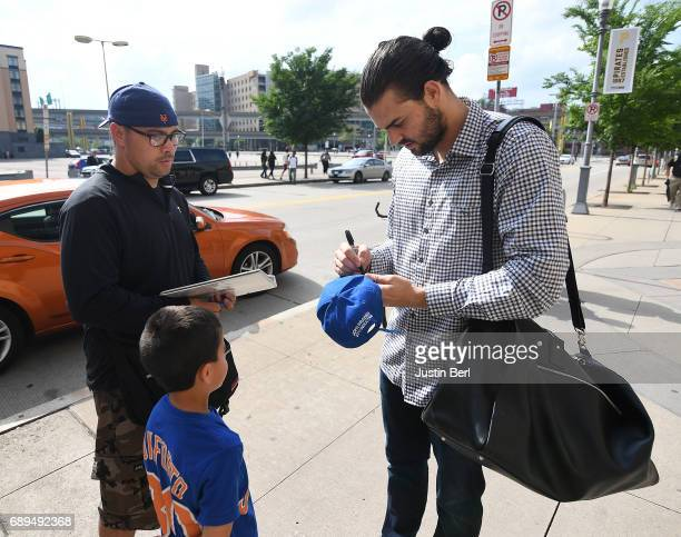 Robert Gsellman of the New York Mets signs autographs for fans outside of PNC Park before the game against the Pittsburgh Pirates on May 28 2017 in...