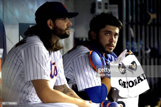 Robert Gsellman of the New York Mets talks with Travis d'Arnaud during the first inning agaisnt the Washington Nationals on September 22 2017 at Citi...