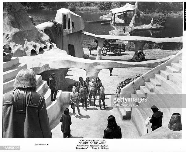Robert Gunner and Charlton Heston are led into a square in a scene from the film 'Planet Of The Apes' 1968