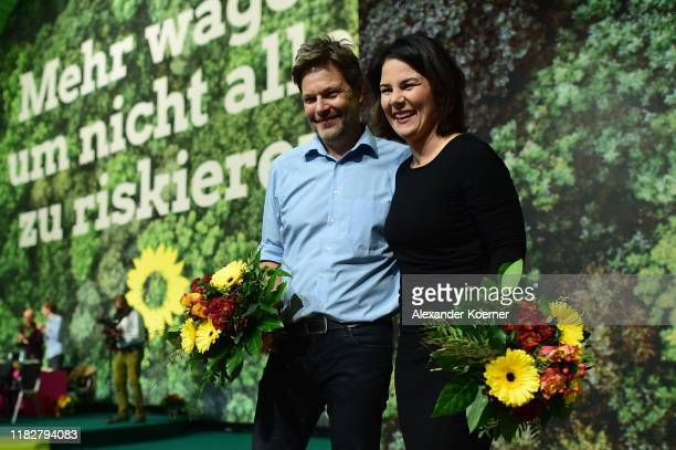 Robert Habeck and Annalena Baerbock smile after being reelected as federal executive board of the German Greens Party at the federal delegates...