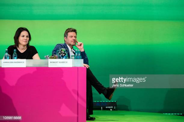 Robert Habeck and Annalena Baerbock the two coleaders of the German Greens Party react on stage at a Greens Party federal congress ahead of next...