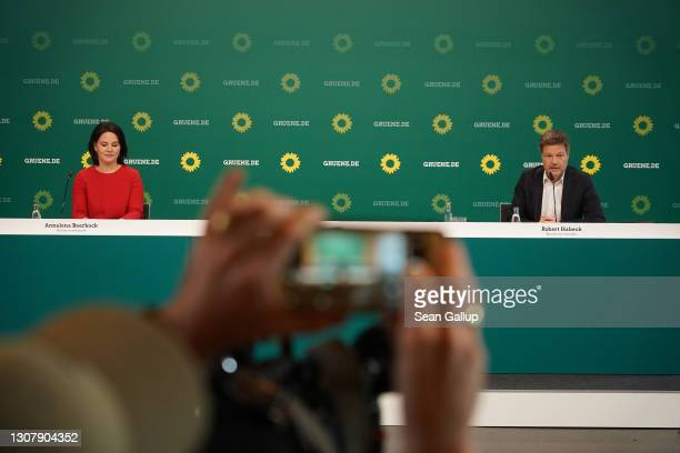 Robert Habeck and Annalene Baerbock, co-leaders of the German Greens Party, speak at a livestreamed, digital press conference to announce the party's...