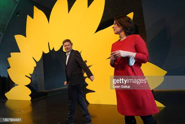 Robert Habeck and Annalene Baerbock, co-leaders of the German Greens Party, arrive for a livestreamed, digital press conference to announce the...