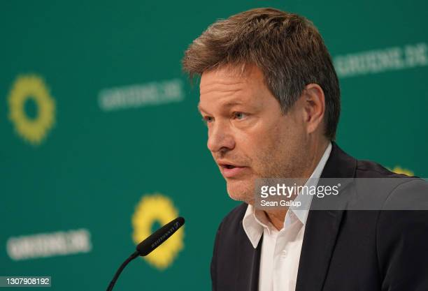 Robert Habeck and Annalene Baerbock , co-leaders of the German Greens Party, speak at a livestreamed, digital press conference to announce the...