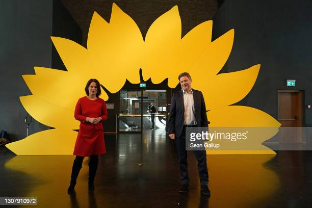 Robert Habeck and Annalene Baerbock, co-leaders of the German Greens Party, pose for photos after a livestreamed, digital press conference to...