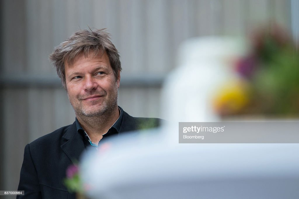 Robert Habeck, candidate for Germanys Green Party, reacts during a news conference on a farm ahead of the German elections in Gremmerup, Germany, on Tuesday, Aug. 22, 2017. Germanys diesel scandaland the response to it by Winfried Kretschmann, the Green premier of Baden-Wuerttemberg stateillustrates the kind of politics Germans might expect if the party entered into a government with Chancellor Angela Merkels Christian Democratic Union after the national election on Sept. 24. Photographer: Krisztian Bocsi/Bloomberg via Getty Images