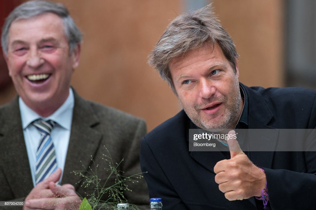 Robert Habeck, candidate for Germanys Green Party, right, gestures as he speaks during a news conference on a farm ahead of the German elections in Gremmerup, Germany, on Tuesday, Aug. 22, 2017. Germanys diesel scandaland the response to it by Winfried Kretschmann, the Green premier of Baden-Wuerttemberg stateillustrates the kind of politics Germans might expect if the party entered into a government with Chancellor Angela Merkels Christian Democratic Union after the national election on Sept. 24. Photographer: Krisztian Bocsi/Bloomberg via Getty Images