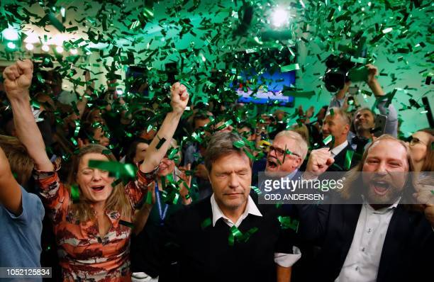 TOPSHOT Robert Habeck coleader of Green party and Anton Hofreiter parliamentary group coleader of the Green party Anton Hofreiter celebrate with...