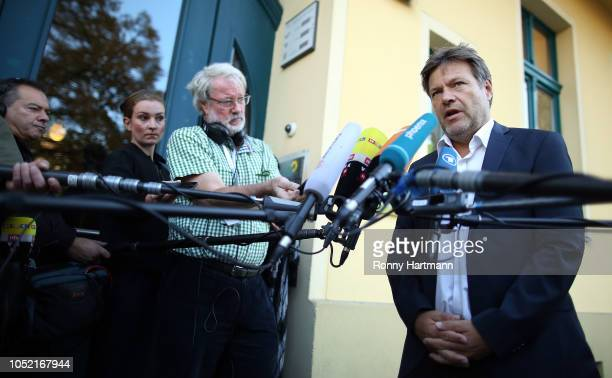 Robert Habeck, co-leader of the German Greens Party , speaks to the media before a meeting of the party leadership the day after the Greens came in a...