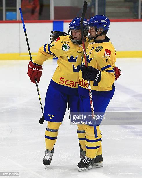 Robert Hagg of Sweden celebrates his third period goal with teammate Anton Karlsson against team USA during the U-18 Four Nations Cup tounament on...
