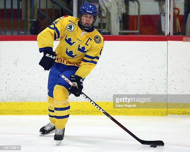 Robert Hagg # of team Sweden looks to pass the puck during the U-18 Four Nations Cup game against team Finland late on November 7, 2012 at the Ice...