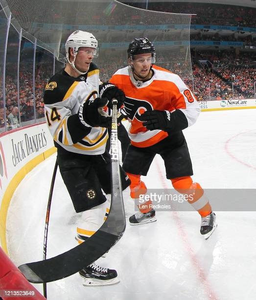 Robert Hagg of the Philadelphia Flyers battles in the corner against Chris Wagner of the Boston Bruins on March 10 2020 at the Wells Fargo Center in...