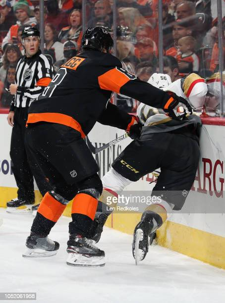 Robert Hagg of the Philadelphia Flyers checks Erik Haula of the Vegas Golden Knights into the boards on October 13 2018 at the Wells Fargo Center in...