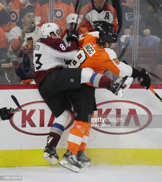 Robert Hagg of the Philadelphia Flyers checks Matt Nieto of the Colorado Avalanche into the boards during the third period at the Wells Fargo Center...