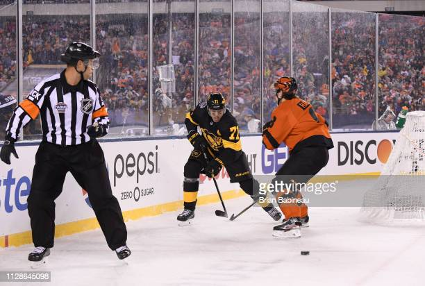 Robert Hagg of the Philadelphia Flyers lines up to check Evgeni Malkin of the Pittsburgh Penguins behind the net during the 2019 Coors Light NHL...