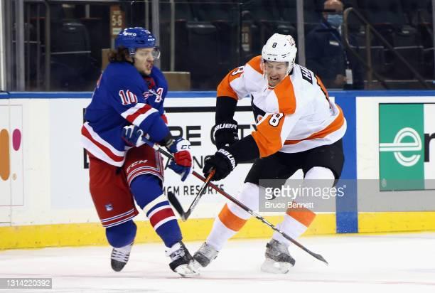 Robert Hagg of the Philadelphia Flyers skates against Artemi Panarin of the New York Rangers at Madison Square Garden on April 23, 2021 in New York...