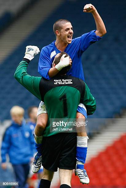 Robert Harris and Jamie MacDonald of Queen of the South celebrate after beating Aberdeen during the Scottish Cup Semi Final between Queen of the...