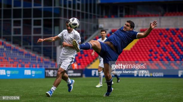 Robert Harrison of CONMEBOL competes with Luis Figo of UEFA during the FIFA Congress Delegation Football Tournament at CSKA Arena during the on June...