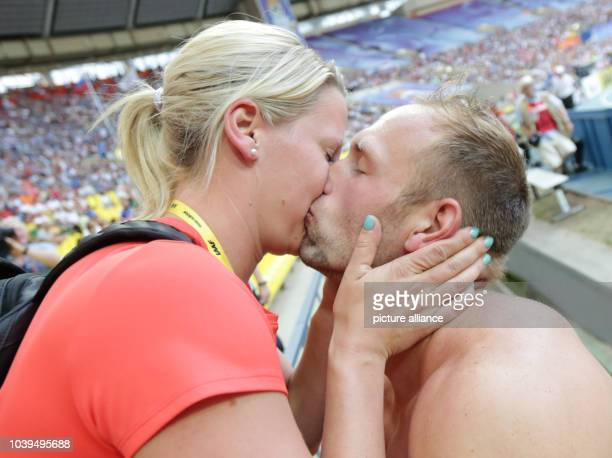 Robert Harting celebrates with his partner Julia Fischer after winning the Men's Discus Throw Event at the 14th IAAF World Championships in Athletics...