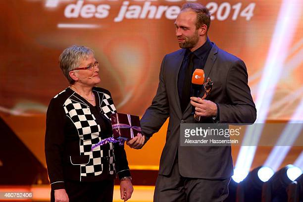 Robert Harting is awarded as Sportsmen of the Year by his grandmother Renate Seidel during the Sportler des Jahres 2014 gala at the Kurhaus...