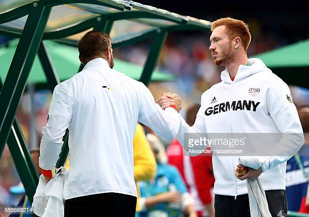 Robert Harting of Germany and Christoph Harting of Germany ahke hands during the Men's Discus on Day 7 of the Rio 2016 Olympic Games at the Olympic...