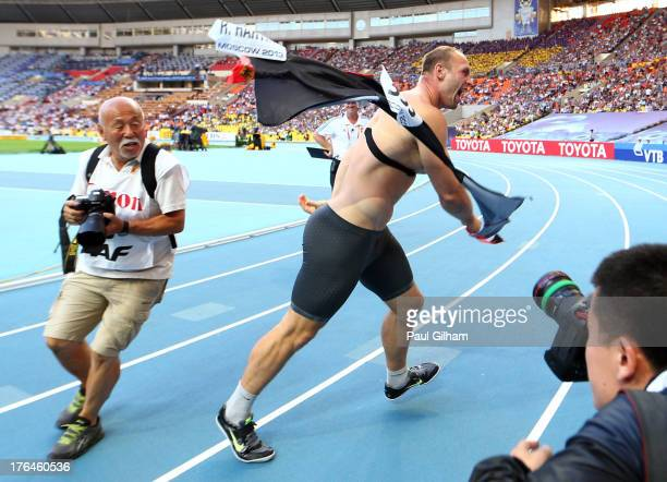 Robert Harting of Germany celebrates winning gold in the Men's discus throw final during Day Four of the 14th IAAF World Athletics Championships...