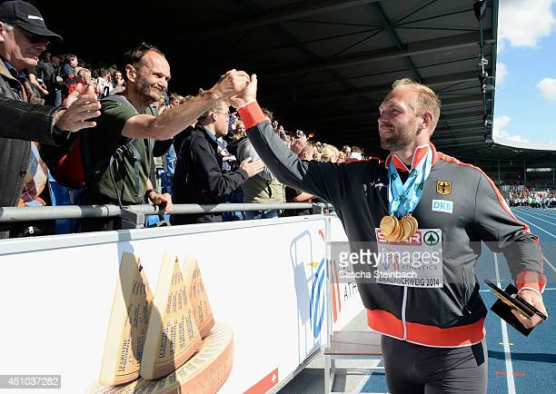 Robert Harting of Germany celebrates with the Fans after the second day of the European Athletics Team Championship at Eintracht Stadion on June 22...