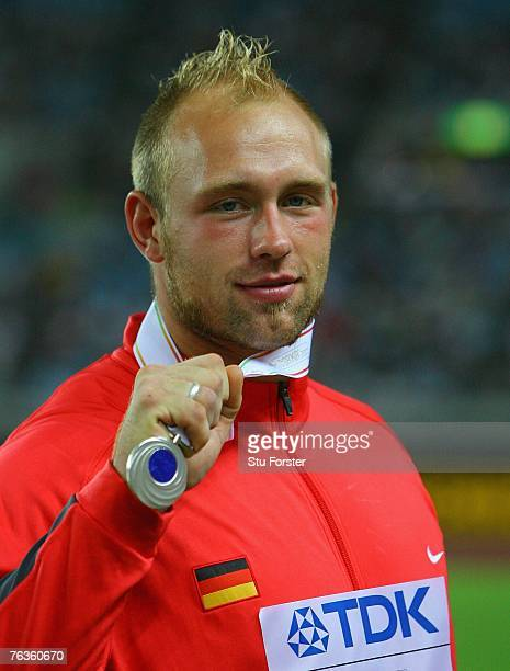 Robert Harting of Germany poses with his silver medal from the Men's Discus Throw on day four of the 11th IAAF World Athletics Championships on...