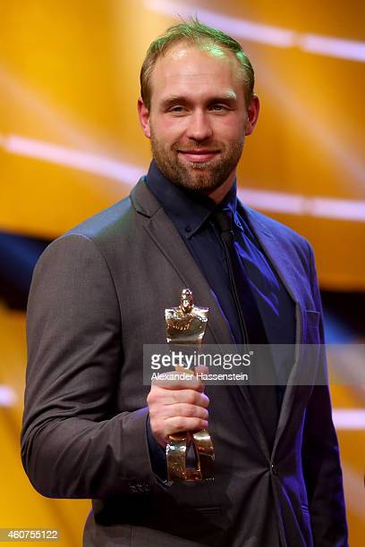 Robert Harting poses with the Athlete of the Year award during the Sportler des Jahres 2014 gala at the Kurhaus Baden-Baden on December 21, 2014 in...