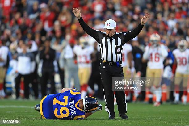 Robert Havenstein of the Los Angeles Rams reacts after suffering an apparent injury during the second half against the San Francisco 49ers at Los...