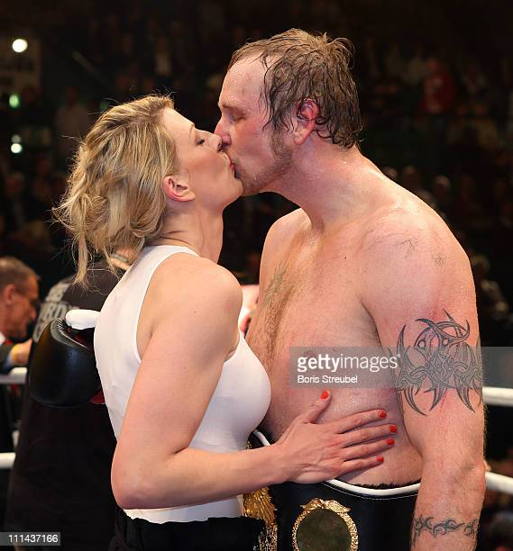 Robert Helenius of Finland and his wife Sandra celebrate after winning the WBO WBA Intercontinental Heavyweight title fight against Samuel Peter of...