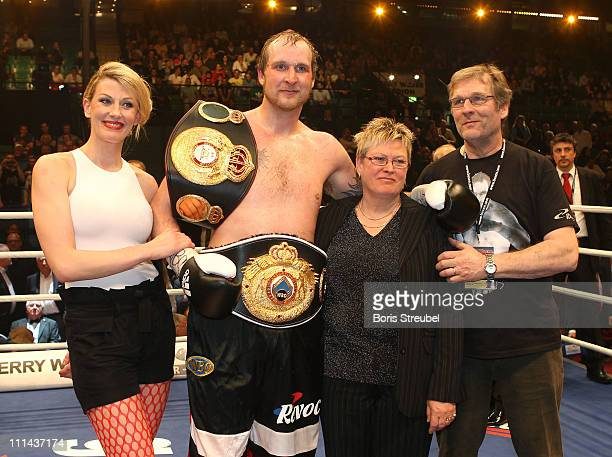 Robert Helenius of Finland and his wife Sandra mother Stina and father Karl celebrate after winning the WBO WBA Intercontinental Heavyweight title...
