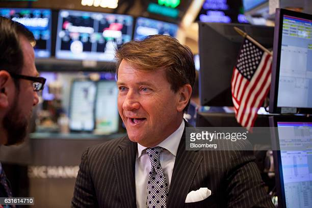 Robert Herjavec founder and chief executive officer of the Herjavec Group right talks with a trader on the floor of the New York Stock Exchange in...