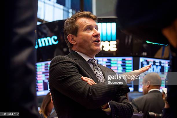 Robert Herjavec founder and chief executive officer of the Herjavec Group center talks with a trader on the floor of the New York Stock Exchange in...