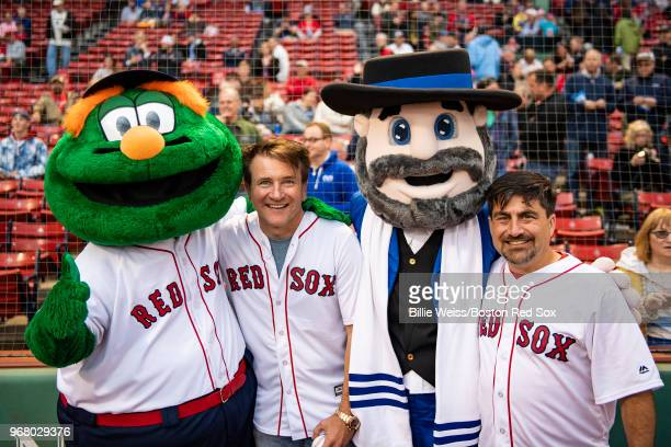 Robert Herjavec of Shark Tank poses with Neal Hoffman creator of Mensch on the Bench with mascots Wally the Green Monster and Mensch on the Bench...