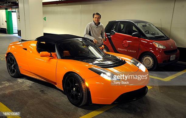 JAN29 2010 Robert Herjavec one of the Dragons of CBC's The Dragons' Den is reviewing the Tesla electric car for Wheels Photographed with city skyline...