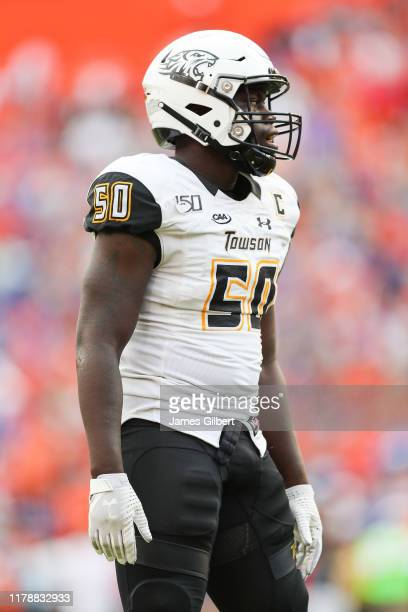 Robert Heyward of the Towson Tigers looks on during the fourth quarter of a game against the Florida Gators at Ben Hill Griffin Stadium on September...