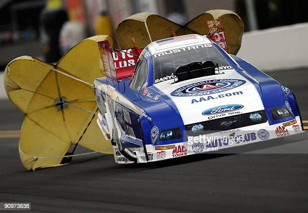 Robert Hight driver of the Auto Club Ford funny car drives during qualifying for the NHRA Carolinas Nationals on September 19 2009 at Zmax Dragway in...