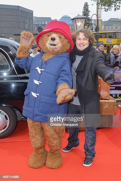 Robert Hofmann and 'Paddington' attend the German premiere of the film 'Paddington' at Zoo Palast on November 30 2014 in Berlin Germany