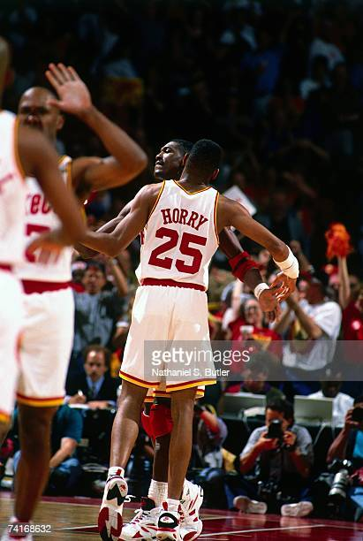 Robert Horry and Hakeem Olajuwon of the Houston Rockets chest bump each other during Game Seven of the NBA Finals played on June 22 1994 at The...