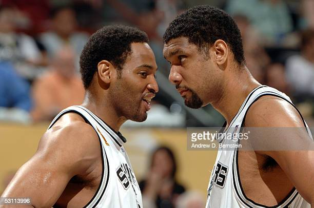 Robert Horry and Tim Duncan of the San Antonio Spurs stare at each other during the game against the Detroit Pistons in Game six of the 2005 NBA...
