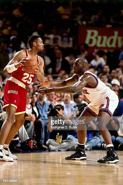 Robert Horry of the Houston Rockets dribbles against Anthony Mason of the New York Knicks during Game Five of the NBA Finals played on June 17 1994...