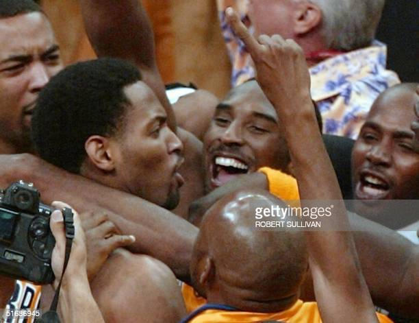Robert Horry of the Los Angeles Lakers is mobbed by teammates including Kobe Bryant after he made the winning three-point basket to give the Lakers a...