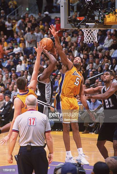 Robert Horry of the Los Angeles Lakers leaps to block Malik Rose of the San Antonio Spurs during the NBA game at Staples Center on October 29 2002 in...