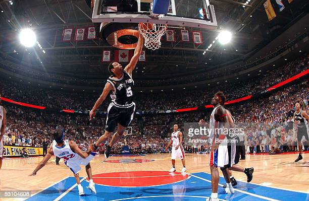 Robert Horry of the San Antonio Spurs dunks against Tayshaun Prince of the Detroit Pistons in Game five of the 2005 NBA Finals at the Palace of...