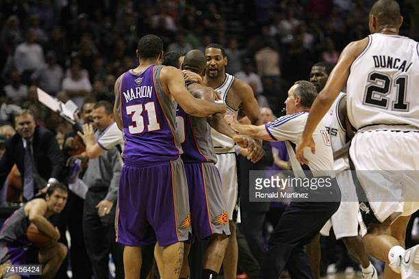 Robert Horry of the San Antonio Spurs exchanges words with several members of the Phoenix Suns after Horry was charged with a flagrant found on Steve...