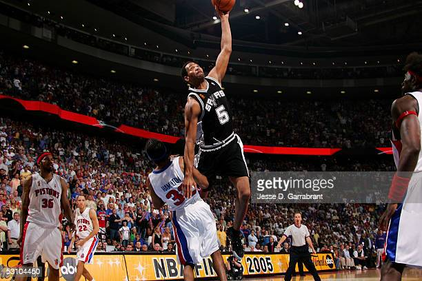 Robert Horry of the San Antonio Spurs goes to the basket and dunks the ball over Richard Hamilton the Detroit Pistons in Game Five of the 2005 NBA...