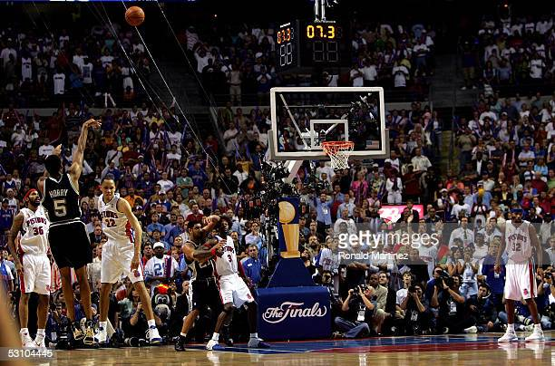 Robert Horry of the San Antonio Spurs makes a threepoint shot to put the Spurs ahead of the Detroit Pistons 9695 in the final seconds of overtime of...