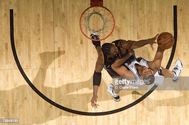 Robert Horry of the San Antonio Spurs shoots against Nene of the Denver Nuggets in Game One of the Western Conference Quarterfinals during the 2007...